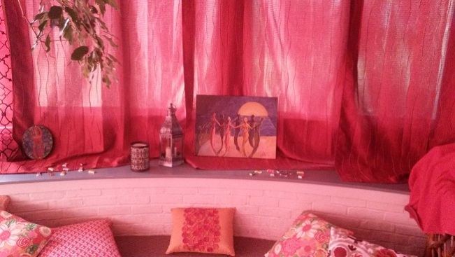 Exotic accessories, my artwork, & images of the Divine Feminine filled the space with an energy that honors women.