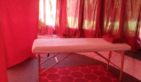A secluded area in the tent for Reiki sessions.
